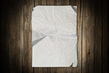 Vintage paper sheet on a wooden background