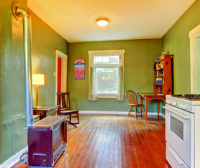Green dining room near kitchen with stove and white stove.