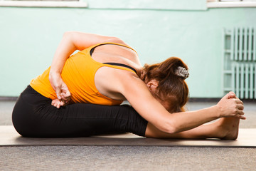 Mature woman exercising yoga