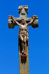 Statue of Jesus on a stone cross