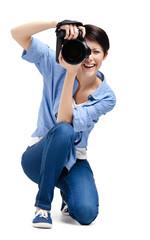 Creative woman-photographer takes photos, isolated on white