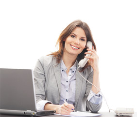 A young brunette businesswoman talking on the phone