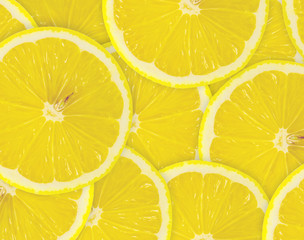Abstract background with citrus-fruit of lemon slices. Close-up.