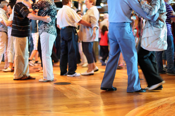 Wall Murals Dance School Many happy senior couples in love dancing on wooden dance floor.