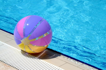 Beachball and swimmingpool. Vacation concept