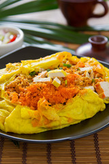 Stir fried  wrapped in omelete [Thai 's food]