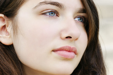 Hopeful young woman looking away