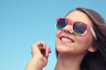 Happy girl in sunglasses.