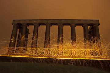Sparking fire rings on National Monument, Edinburgh, Scotland.