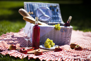 Wine and picnic basket on the grass