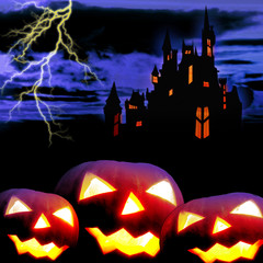 Castle and three pumpkins in night