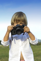 Young boy with vintage photo camera