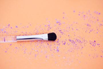 cosmetics: eyeshadow and make-up brush