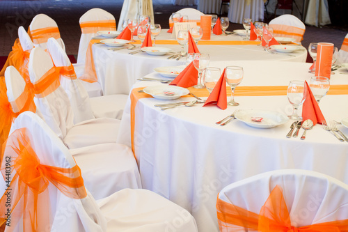 Wedding table with orange decorations stock photo and royalty free wedding table with orange decorations junglespirit Images