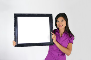 Brunette pointing to blank art frame