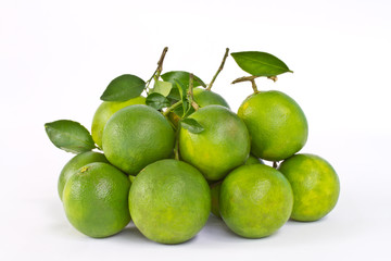 Stack of green sweet oranges on white background