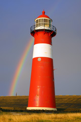 Fototapete - Lighthouse on background of the Rainbow.