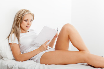 blonde woman reading book