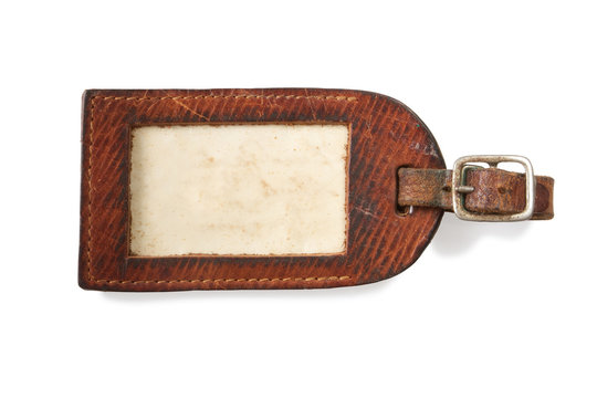 leather luggage tag isolated on white