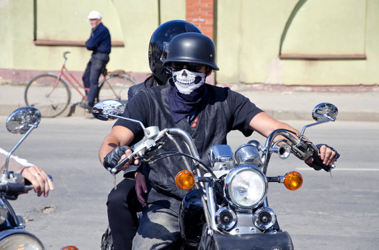 biker with mask on motorcycle