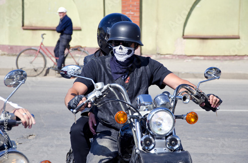 Wall mural biker with mask on motorcycle