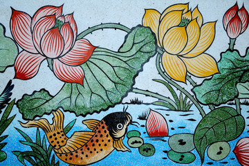 Fish of Wealth and Lotus painting on stone wall.