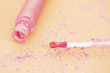 pink lipgloss and eyeshadow powder