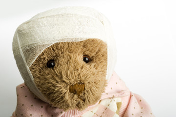 Teddy bear with bandage on the head