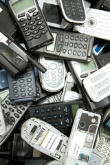 scatered mobile phones ready for recycle