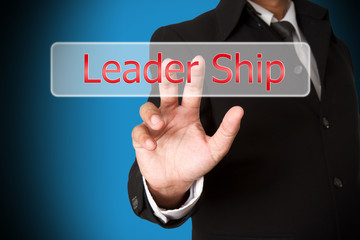 business hand pushing the leader ship  virtual button as concept