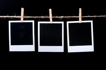 Blank photo frames on line on black