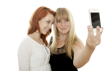 young beautiful red and blond haired girls photograph themself