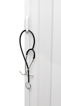 Medical stethoscope hanging on the door