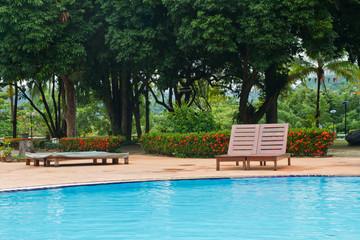Wood chair on pool deck