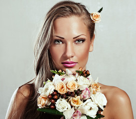 beautiful woman with flowers. makeup