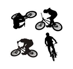 контуры спортсмена занимающегося акробатикой на велосипеде