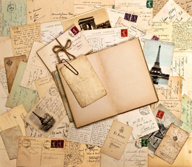 old letters, french post cards and open book