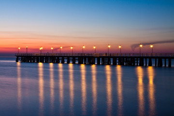 In de dag Pier wschód słońca nad bałtykiem