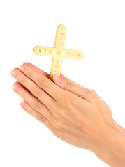 Hands in Prayer with Crucifix on white background close-up