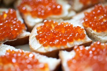 Sandwiches with red caviar . close-up