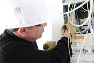 Electrician repairing electric meter