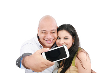 A young couple taking their picture on a mobile phone (focus on