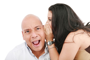 Closeup portrait of a cute young woman whispering in her husband