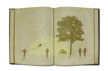 Children playing on old book with tree