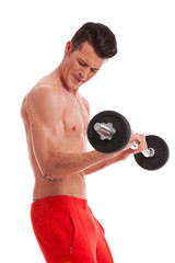 powerful muscular shirtless man lifting weights