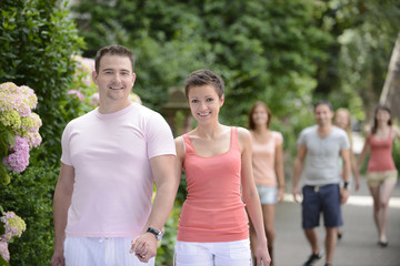 group of couples on a walk outdoors