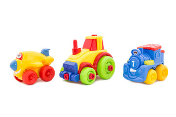 Set from three plastic toys - the plane, a tractor and a steam l