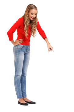 blonde woman pointing down on white background