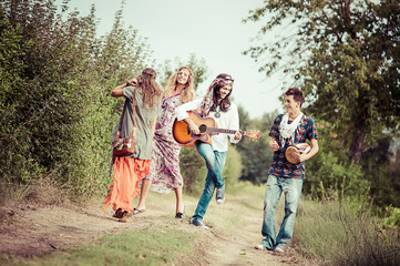 Hippie Group Dancing in the Countryside