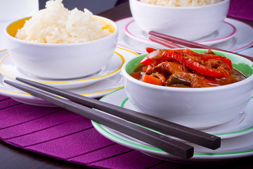 Chinese bowls with rice and sweet and sour chicken